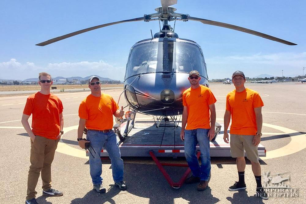 Crew present for an HVAC job by aerial crane. Corporate Helicopters of San Diego.