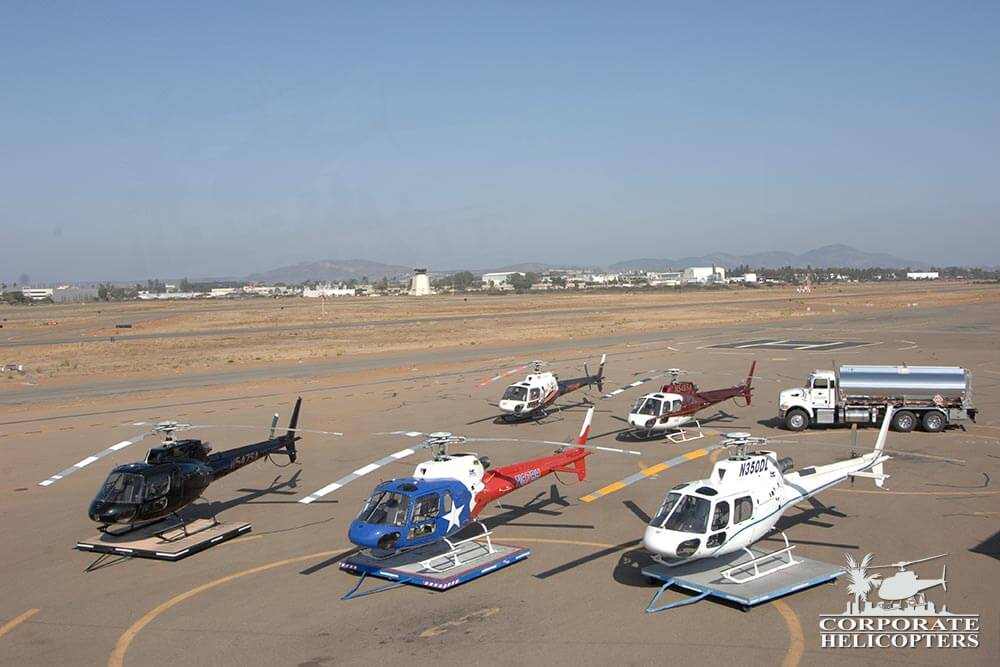 Astar fleet with a fueling truck at Corporate Helicopters of San Diego