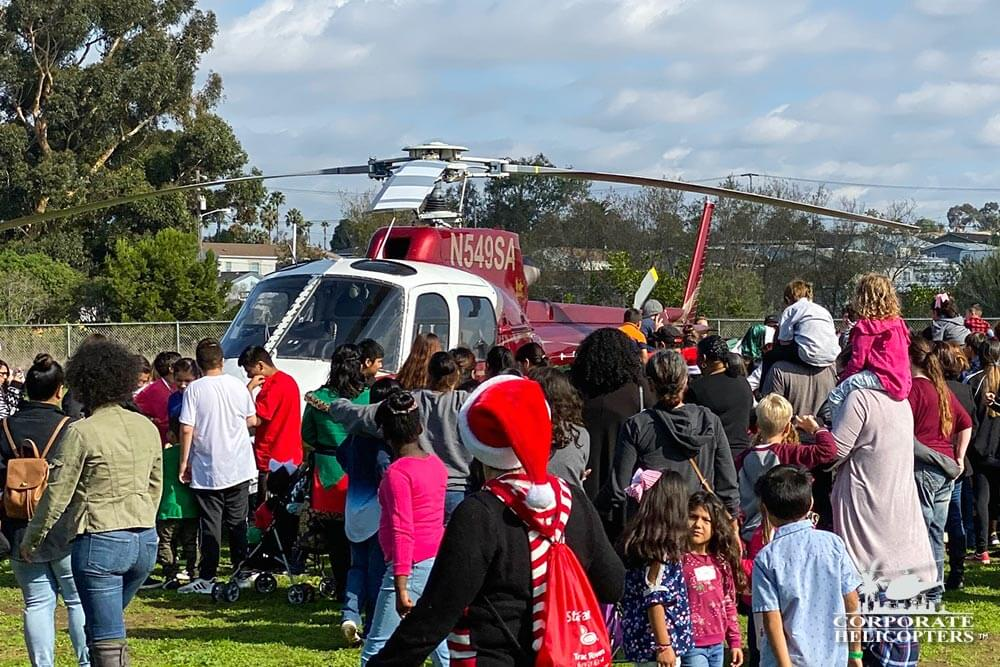 Irish Santa and helpers arrive by helicopter in San Diego