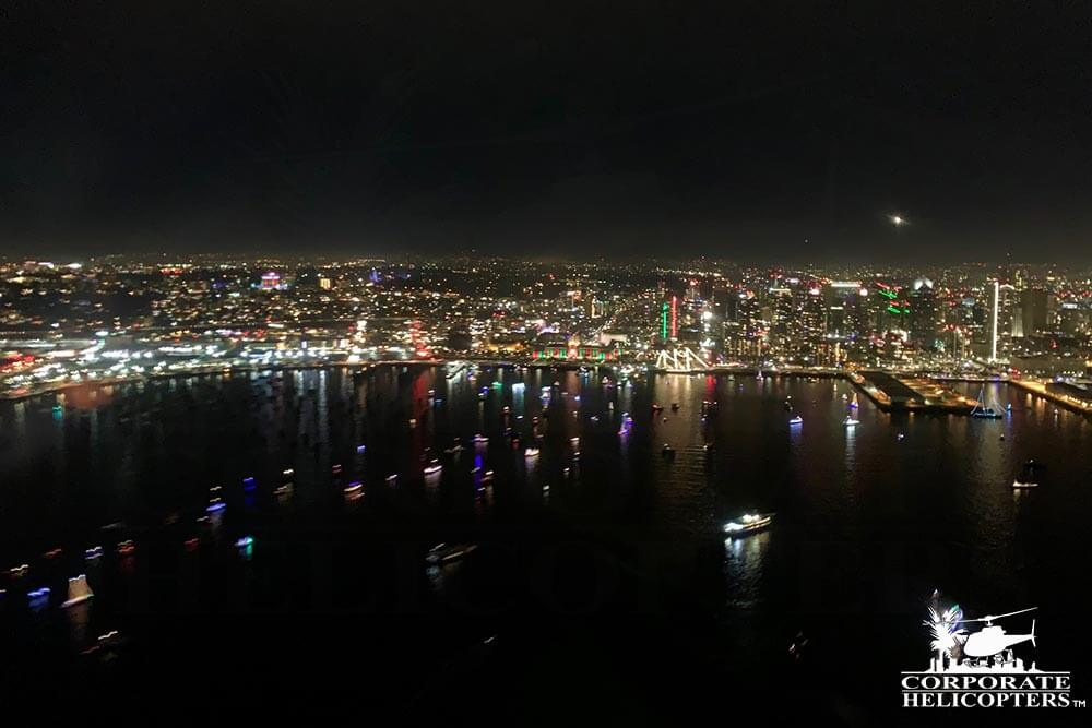 San Diego Bay Parade of Lights. Shot during the 'San Diego City Lights' holiday night time helicopter tour from Corporate Helicopters.