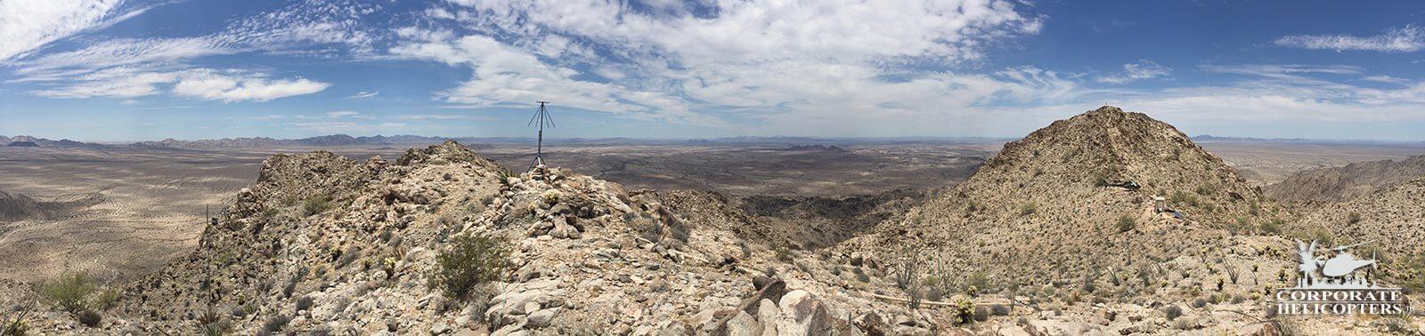 Satellite tech crew transport via helicopter in the desert.